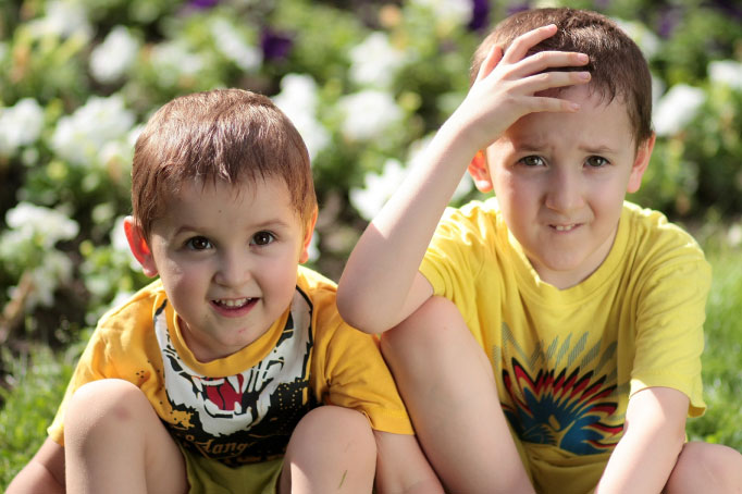 two young boys in yellow shirts