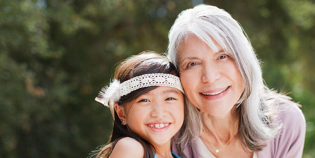 Grandma and granddaughter smiling