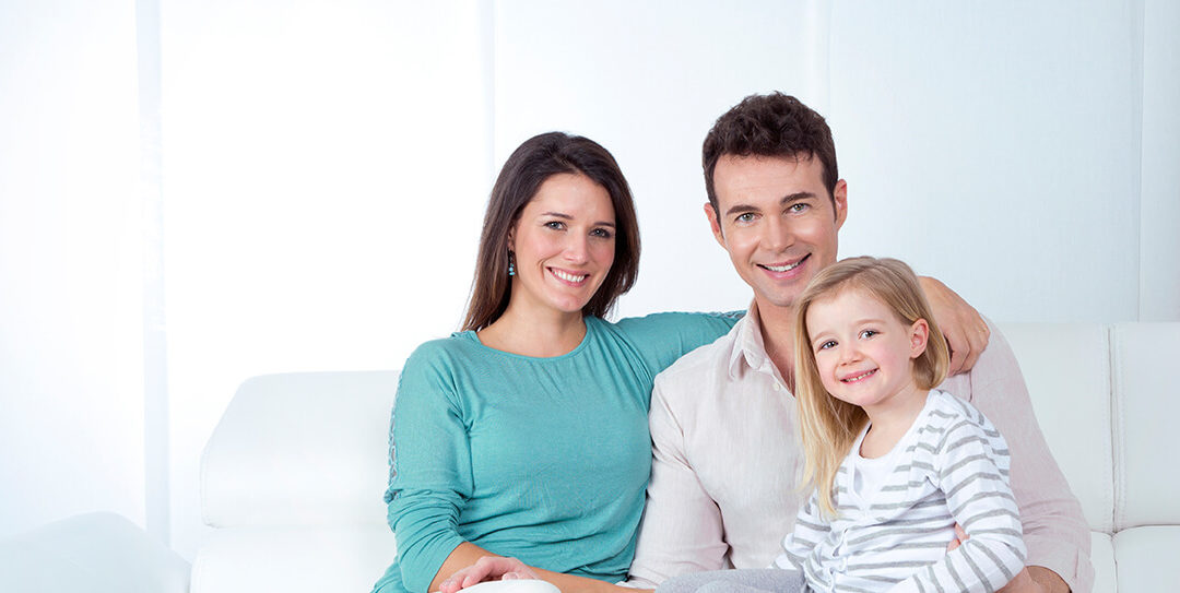 Parents and daughter smiling