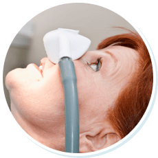 woman in dental chair receiving sedation