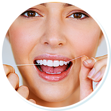 woman flossing her bright, white teeth