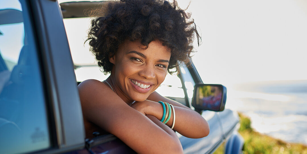 Woman leaning out of window smiling