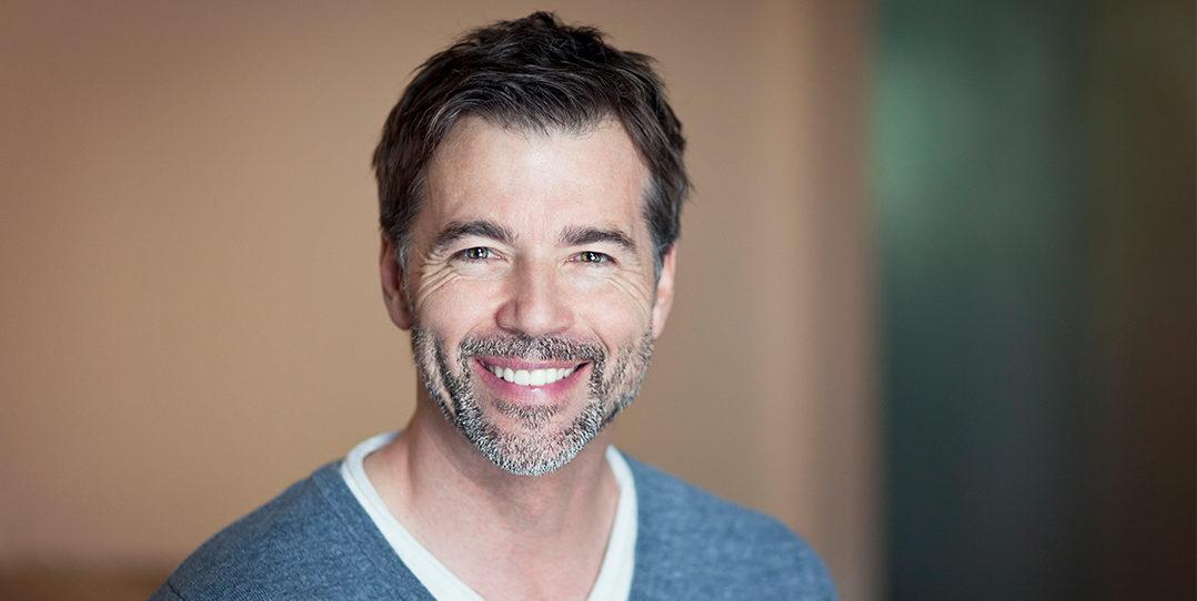 Man with dentures smiling